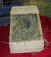 hay packed in the nest box for dwarf breed rabbit mother